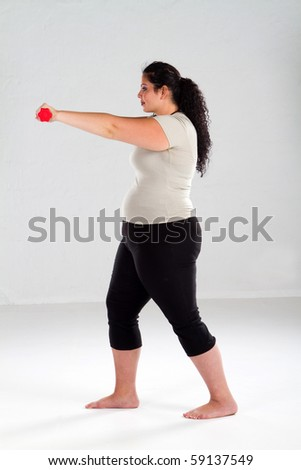 Smiling Plus Size Female Getting Ready to Exercise - stock photo