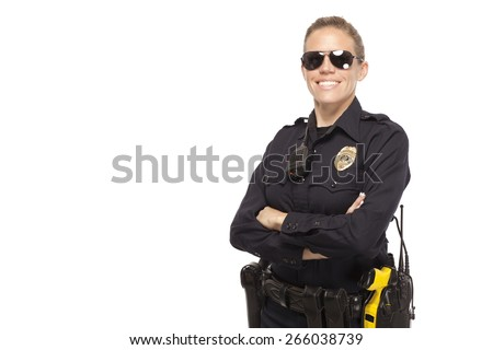 Smiling police officer in sunglasses posing with hands crossed against white background - stock photo