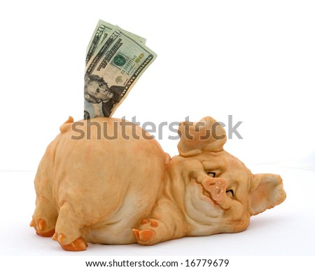 Smiling porcelain pig piggy bank with twenty dollar bills over white - stock photo