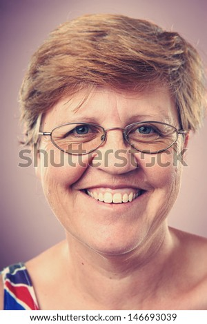 Smiling portrait face of real woman with retro colour and high detail - stock photo