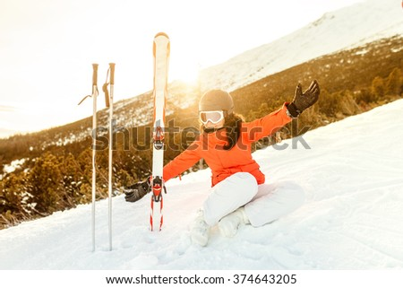 Smiling portrait of a young woman enjoying the mountains. Happy skier relaxing  - stock photo