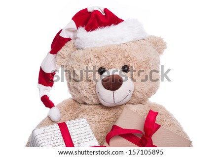 Smiling portrait  teddy bear wearing Christmas hat with gift boxes on white background - stock photo