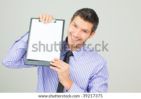 Smiling positive businessman with blank clipboard for your text