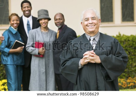Smiling Preacher with Congregation - stock photo
