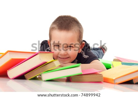 smiling preschooler on floor with pile of books, close up, isolated on white - stock photo