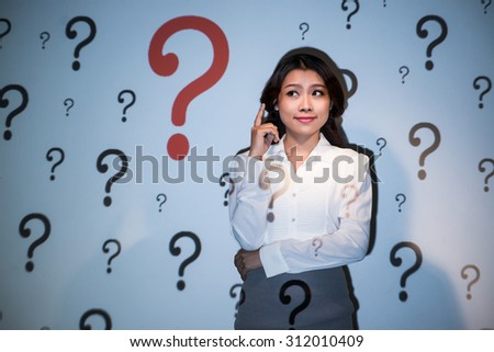 Smiling pretty business woman having many questions