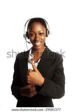 Smiling pretty business woman with headset - stock photo