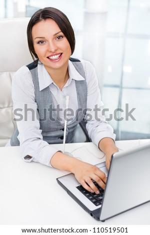 Smiling pretty business woman with microphone. She is salesperson or support team worker - stock photo