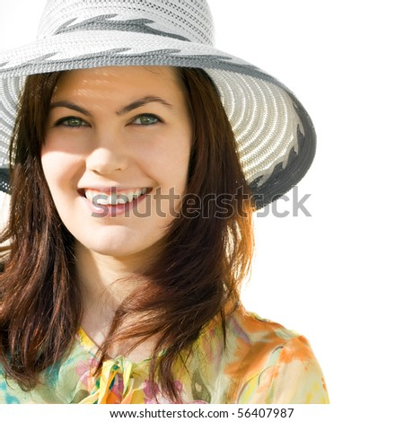 Smiling pretty girl in a hat isolated over white - stock photo