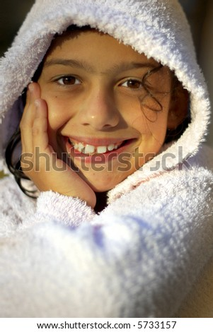 Smiling pretty girl in white bathrobe after bath - stock photo