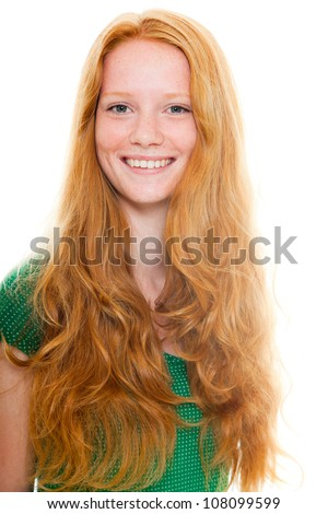 Smiling pretty girl with long red hair wearing green shirt. Fashion studio shot isolated on white background. - stock photo