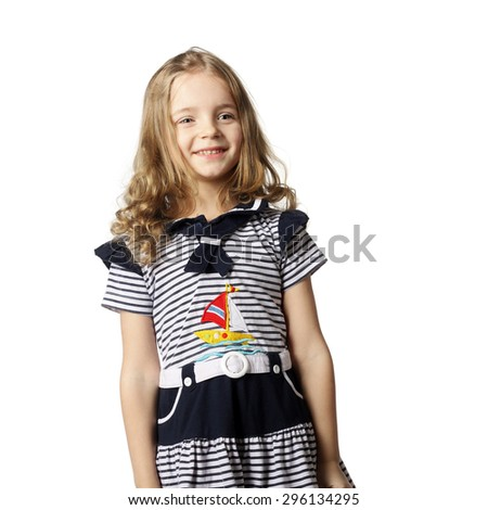smiling pretty little girl in marine dress