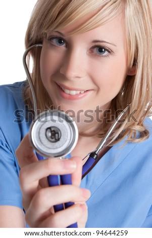Smiling pretty nurse holding stethoscope - stock photo