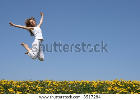 Smiling pretty woman in a beautiful jump. - stock photo
