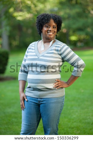 Smiling Pretty Young African American Female Walking Outdoor in Park