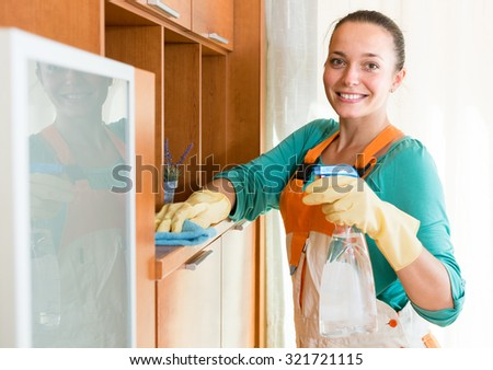 smiling professional russian cleaner  cleaning the office - stock photo