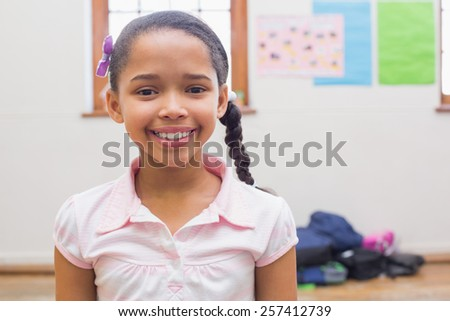 Smiling pupil in classroom at the elementary school - stock photo