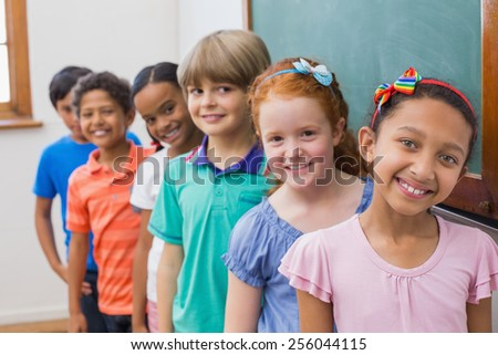 Smiling pupils in classroom at the elementary school
