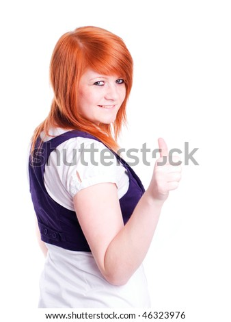 smiling red hair teenager pointing ok sign over white background