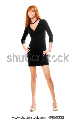 Smiling red-haired young woman in black dress