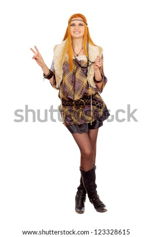 Smiling red-haired young woman in the image of hippies - stock photo