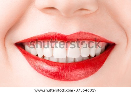 Smiling Red Lips with glossy lipstick, macro