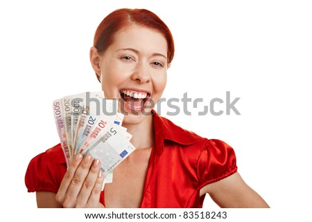 Smiling redhaired woman holding Euro money bills