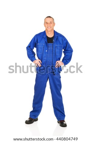 Smiling repairman with hands on hips - stock photo