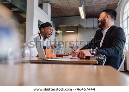 Smiling Restaurant Manager Sitting Table Talking Stock Photo - Restaurant table management software free