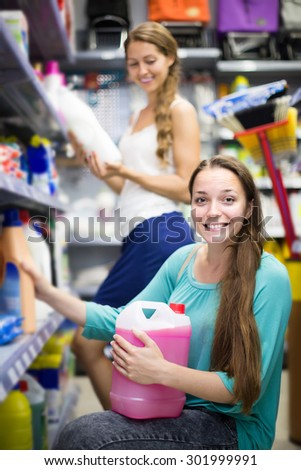 smiling russian people buying detergents for house in the shopping mall