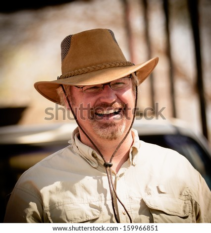 smiling safari man in Africa - stock photo