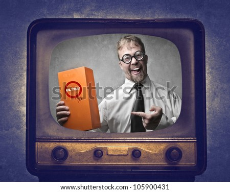 Smiling salesman advertising a product at the television