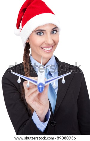 smiling Santa businesswoman  holding  plane, concept - Christmas  travel, isolated on white background