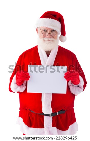 Smiling Santa Claus holding a blank sheet of paper - stock photo