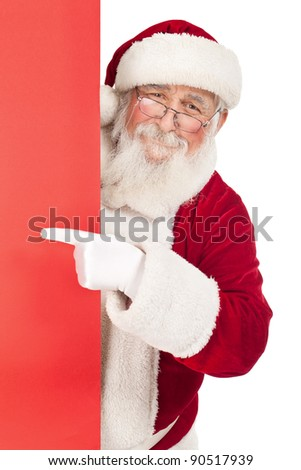 smiling Santa Claus pointing in red blank sing , isolated on white background - stock photo