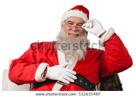 Smiling santa claus sitting on chair against white background