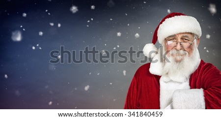 smiling Santa Claus with copyspace, portrait on winter background - stock photo