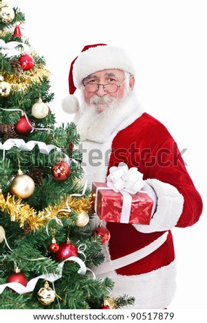 smiling Santa Claus with real beard holding gift for Christmas - stock photo