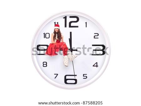 smiling santa girl sitting on a clockwise, isolated on white background - stock photo