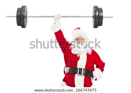 Smiling Santa holding a heavy barbell in one hand and looking at camera isolated on white background - stock photo