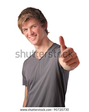 Smiling satisfied man with thumbs up - stock photo