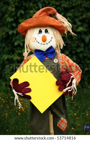 Smiling scarecrow with blank page ready for your message - stock photo