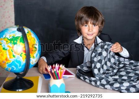 Smiling school boy with schoolbag - stock photo