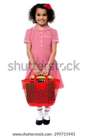 Smiling school girl carrying a basket bag - stock photo