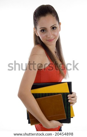 smiling school girl with books on an isolated white background - stock photo