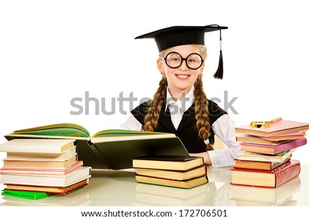 Smiling schoolgirl engaged at the table with books. Isolated over white. - stock photo