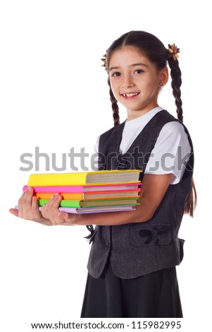 Smiling schoolgirl standing with colorful stack of books in hands, isolated on white - stock photo
