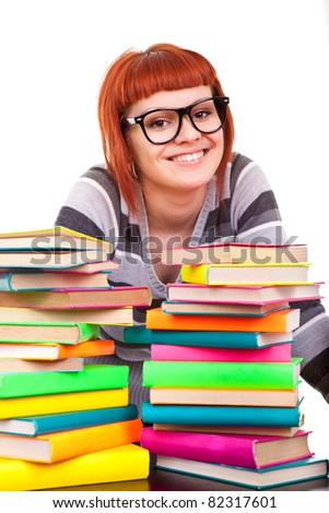 smiling schoolgirl with stack of books, isolated on white background