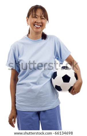 Smiling senior Asian woman holding a soccer ball football isolated over white background - stock photo