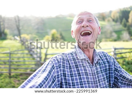 Smiling senior authentic man - stock photo